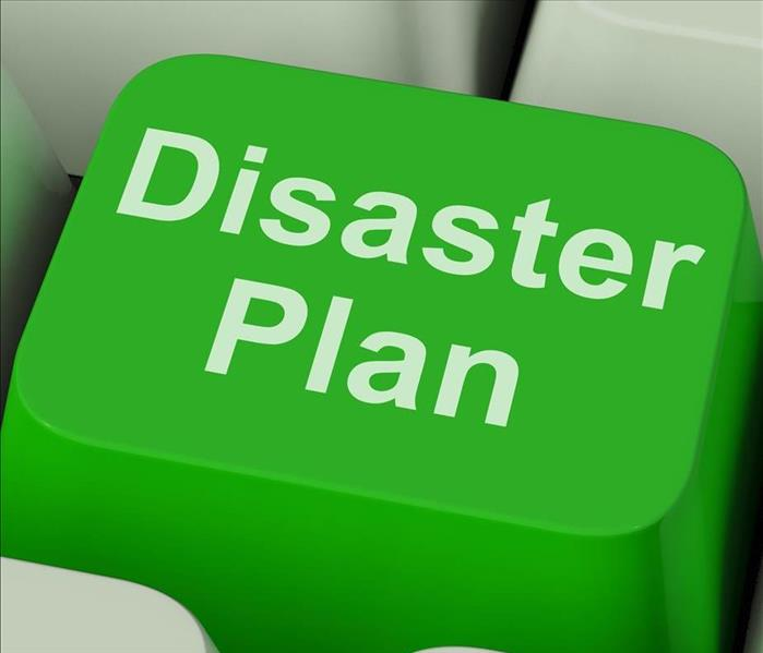 "Green button of the keyboard of a computer with the word ""Disaster Plan"""